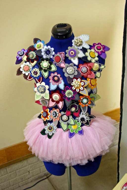 The pins were displayed on a dressform and looked like butterflies.