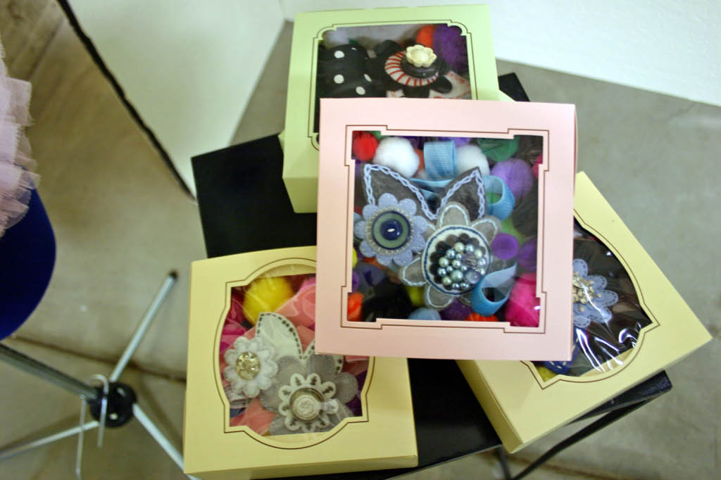 Wrist corsages were in little candy boxes with pom pom stuffing.