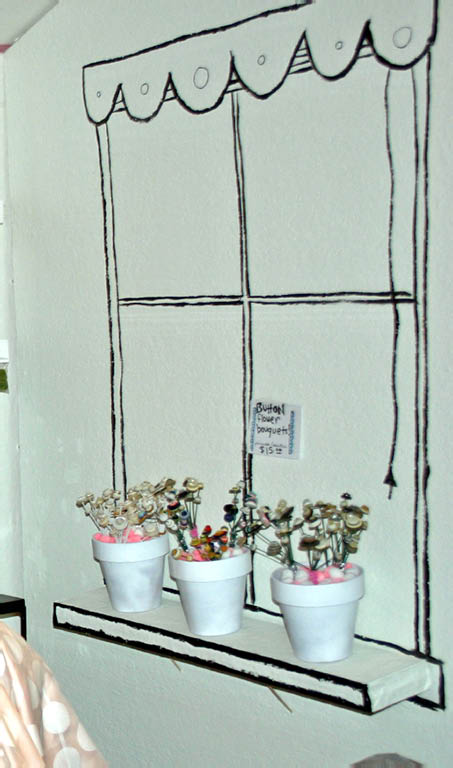 Paper Mache flowerpots filled with Oasis and Pom Poms held the button flowers.