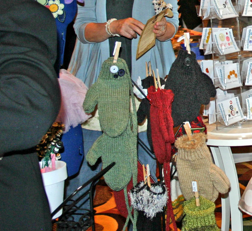 Natasha's Handmade Mittens were displayed on a mitten tree with a clothespin.