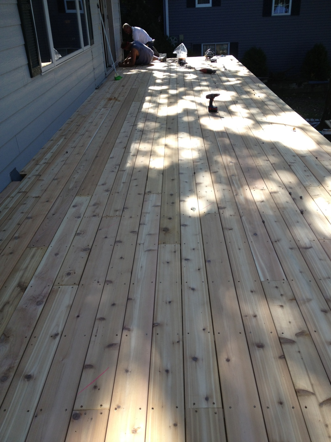The New Decking is now in place. The cedar is so beautiful. I wish it would stay this way......