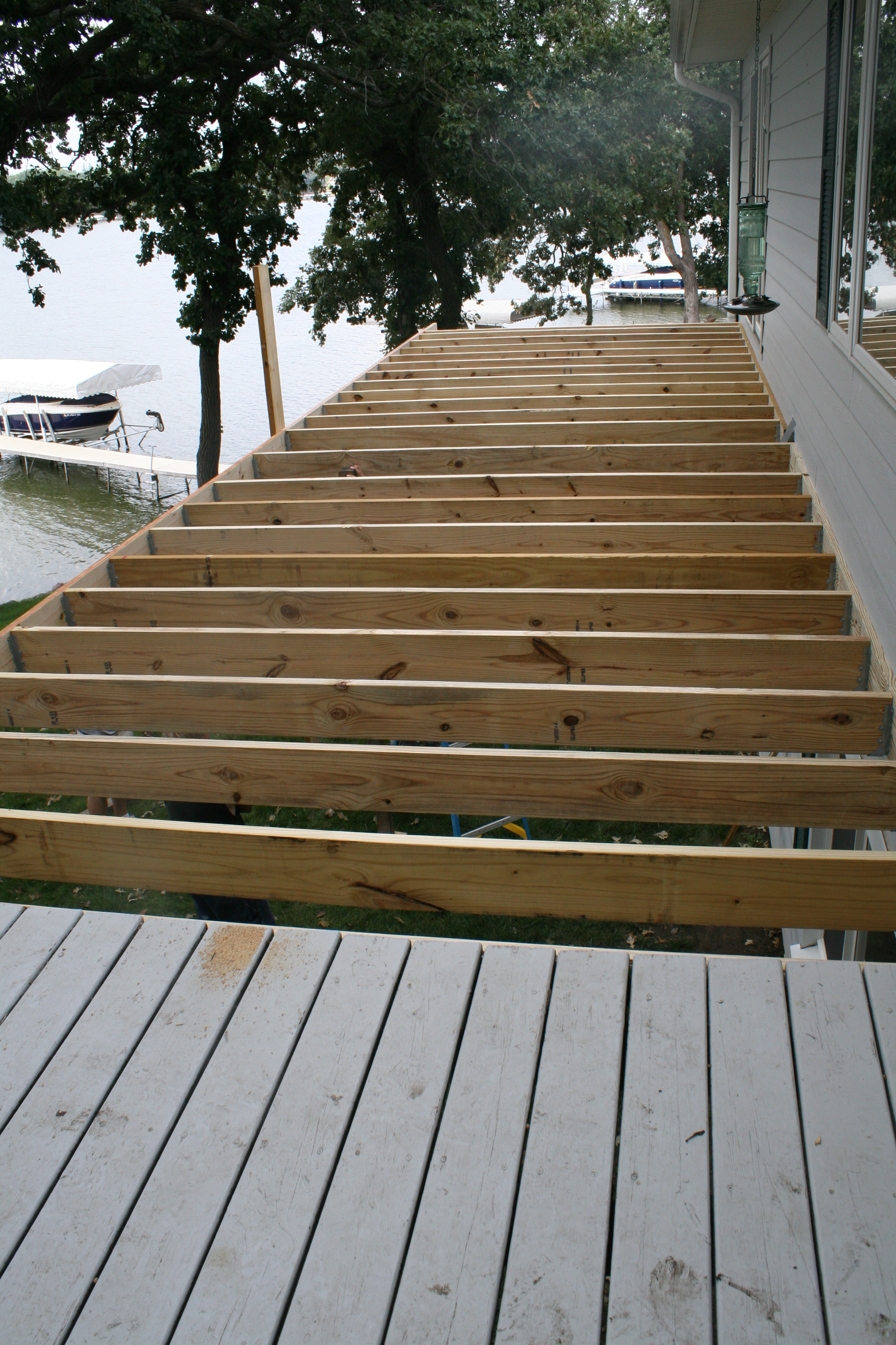 Piece by piece the deck is growing.