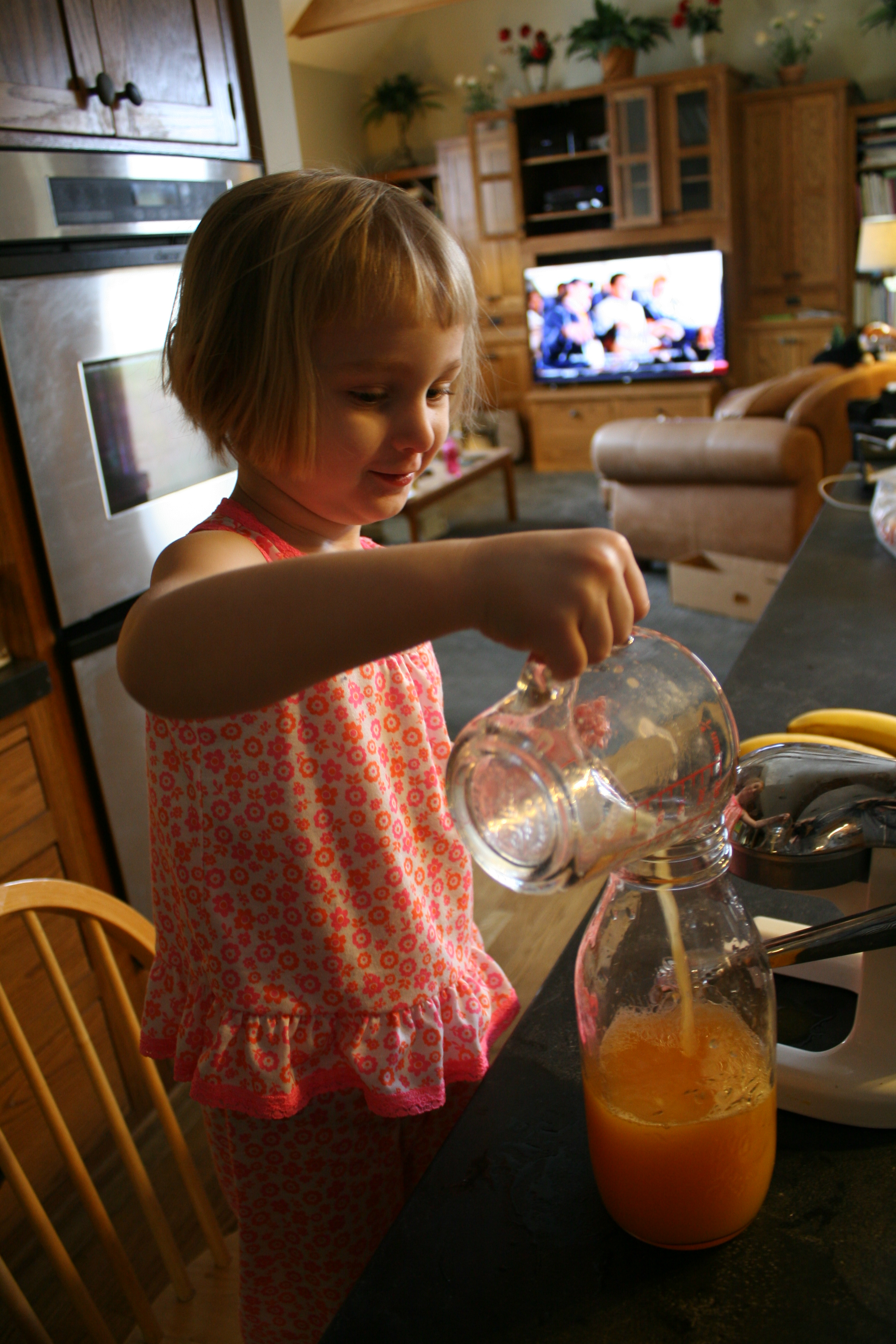 Pouring juice into pitcher
